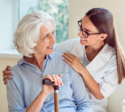 Kind one. Smiling senior woman with her home caregiver
